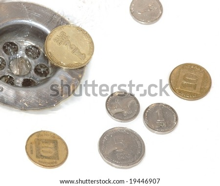 Money down the drain - stock photo