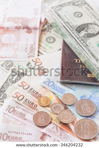Money euro banknotes,coins,us banknotes and passport on background