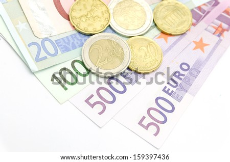 Money euro coins and banknotes - stock photo
