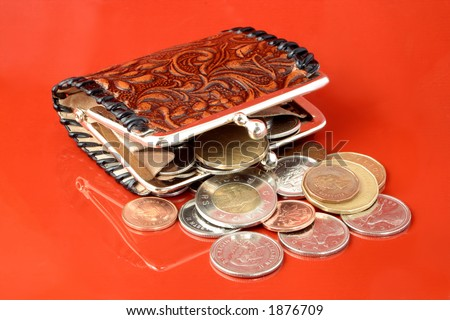 money falling out of change purse - stock photo