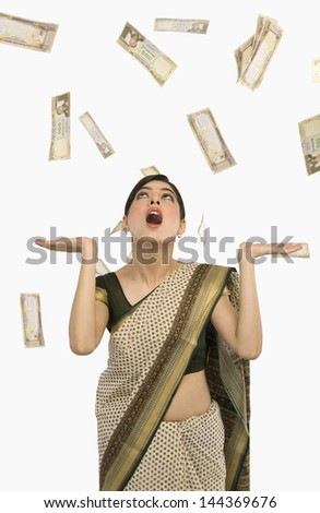 Money falling over a woman - stock photo