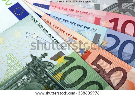 Money: fan made of euro banknotes - stock photo
