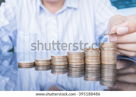 Money, Financial, Business Growth concept, BusinessMan hand put money coins to stack of coins - stock photo