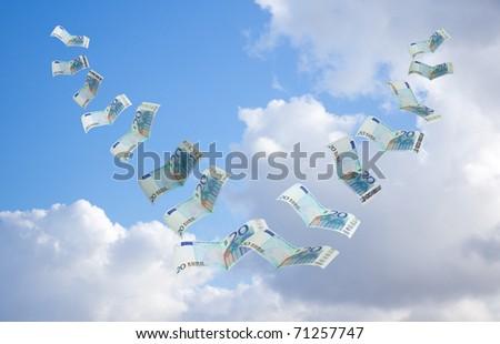 money flying away into the sky - stock photo