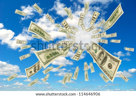 Money flying out of the sky. - stock photo