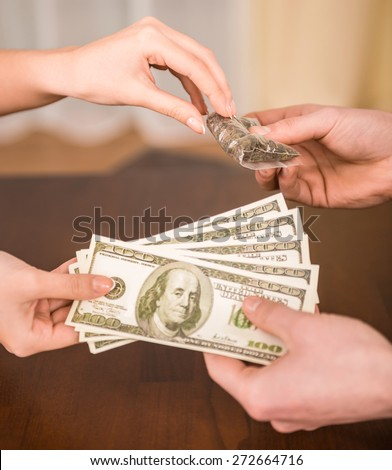 Money for grugs. Drug dealer and addict trading. Close-up. - stock photo