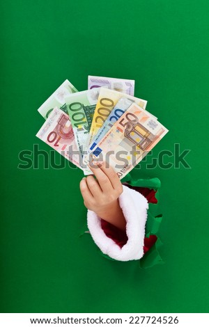 Money for the christmas shopping rush handed to you - stock photo