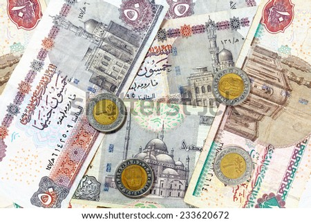 Money from Egypt, pound banknotes and coins. - stock photo