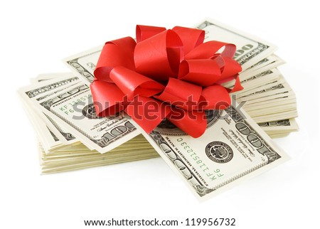 Money gift (big stack of dollars with red bow isolated on white background) - stock photo