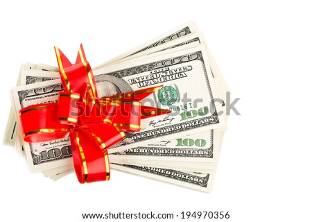Money gift (big stack of dollars with red bow isolated on white background - stock photo