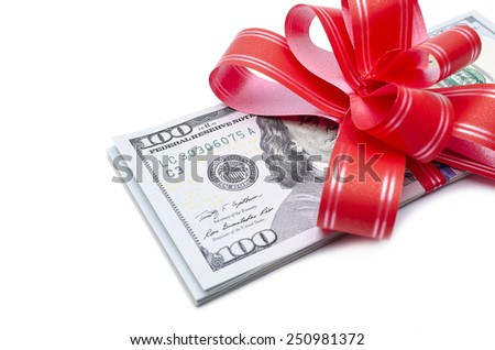 Money gift. Stack of dollars with red bow on white background - stock photo