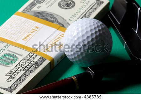 money golf club and ball on green