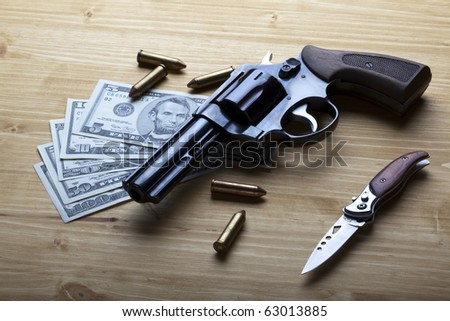 Money, gun and knife - stock photo