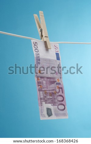 Money Hanging Out to Dry - stock photo