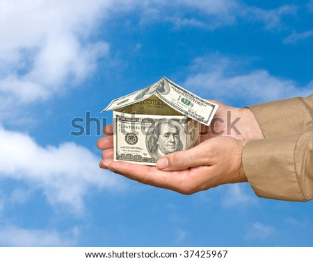 Money house in hands
