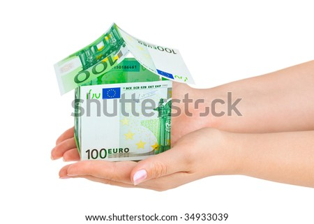 Money house in hands isolated on white background
