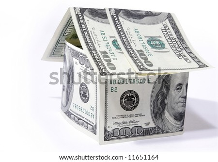 Money house made from dollars isolated on white background - stock photo