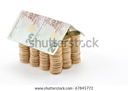 Money house made from stack of coins and Turkish lira banknote roof - isolated with reflection - stock photo