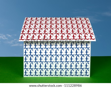 Money house - pounds sterling, investment, mortgage - stock photo