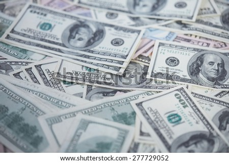 money in a chaotic manner on the floor