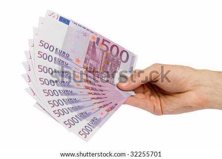 Money in a hand - stock photo