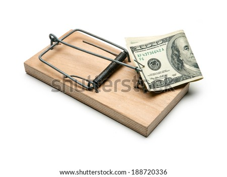 Money in a mousetrap. Mortgage / studio photography of one hundred dollar bill and mousetrap on a white background  - stock photo