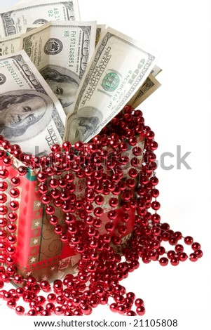 Money in a red gift box on a white background