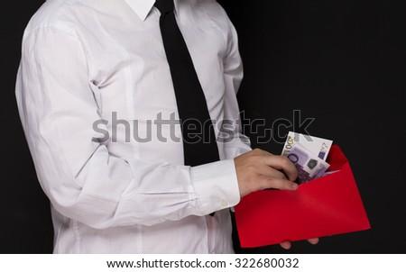 Money in an envelope - stock photo