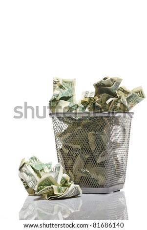 Money in basket. Isolated over white. - stock photo