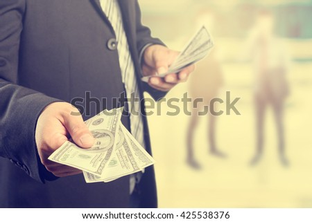 Money in Businessman hand , US dollar,investment, success and profitable business concepts,vintage process style - stock photo