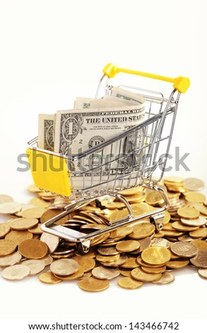 Money in cart on white background