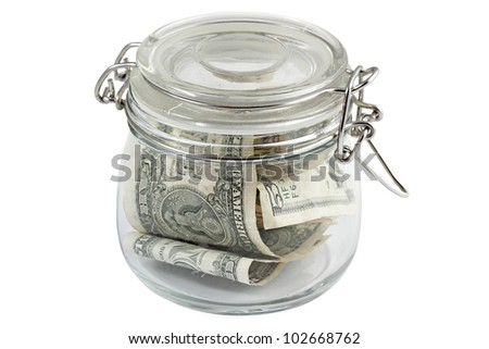 Money in glass jar on white background