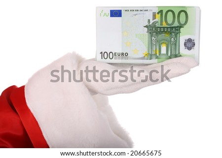 Money in hand of santa claus. - stock photo