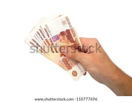 Money in hand. Russian banknotes.