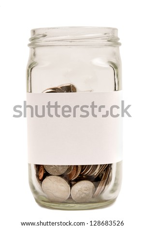 Money In Jar/ Blank Label On Jar / Isolated on white with copy space. Vertical shot. - stock photo