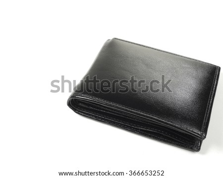 Money in leather wallet isolated on white background - stock photo