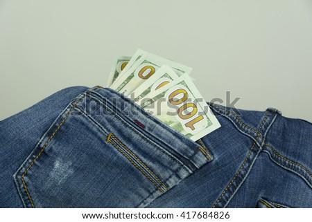 Money in pocket jeans - stock photo