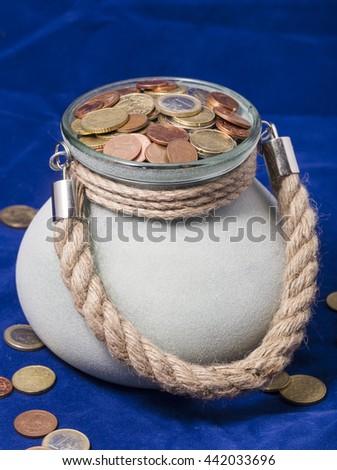 Money in pot - stock photo
