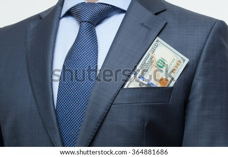 Money in the breast pocket - closeup shot