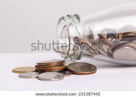 money in the glass bottle isolate on white background - stock photo