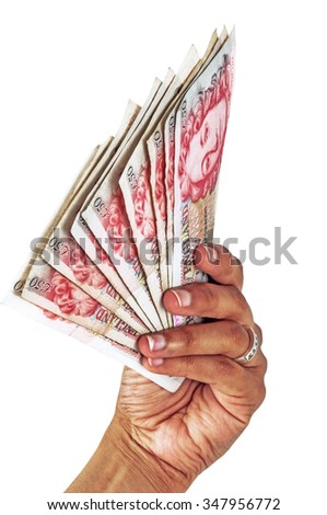 Money in the hand waving rich successful and lucky concept