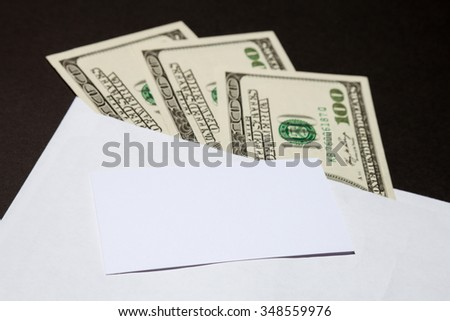 Money in the white envelope, closeup shot