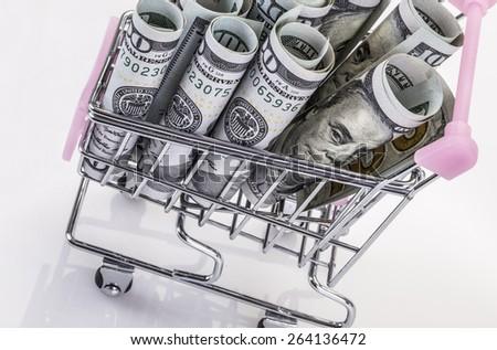 money in trolley - stock photo