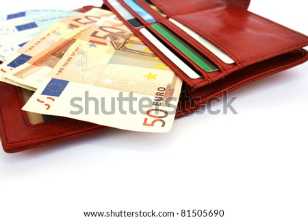 Money in wallet isolated on white background. - stock photo