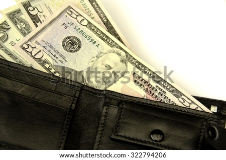 Money in  wallet. On a white background. Isolated.