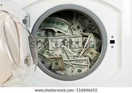 money in washing machine close up - stock photo