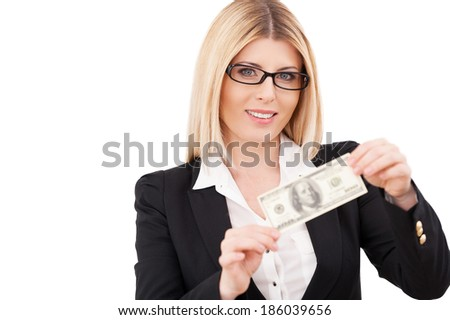 Money is a power. Confident mature businesswoman holding one hundred dollar bill and smiling while standing isolated on white - stock photo