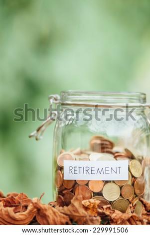 Money jar full of saved money for retirement - stock photo