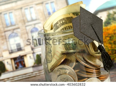 Money jar will help with some of the payments for your children's college or university fund - stock photo