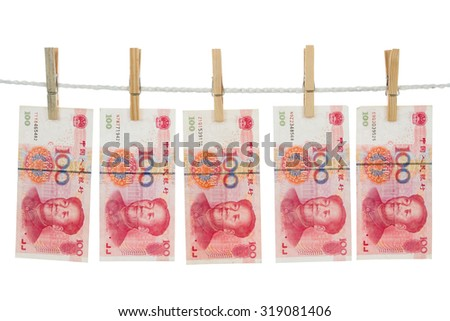 Money laundering concept with China notes on clothesline in plain isolated white background. - stock photo